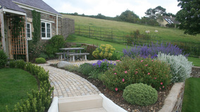 Alison Bockh Garden Design and Landscaping - North Devon - Building the steps to granny annexe complete with cottage garden