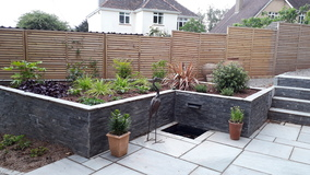 Alison Bockh Garden Design and Landscaping - North Devon - raised beds and leat in upper corner and steps to entrance