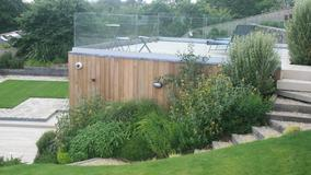 Alison Bockh Garden Design and Landscaping - North Devon - Modern deck over gymnasium overlooking lawned area